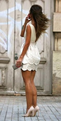 White scalloped party dress. I think the shoes are a terrible choice though .
