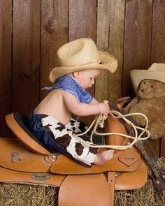 Little cowboy @cheryl ng ng ng ng Kirkland-Bazor, can we please figure out how to do this soon with grandpas saddle??