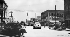 Lufkin Ave. at First St., 1939-40.  Standing on Lufkin Ave. near 'Cotton Square' looking eastward. 'Old' Perry Brothers Five & Dime store on the right.