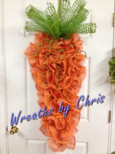 "The Easter Bunny is sure to be impressed by this 52"" long carrot! Paper mesh and orange metallic deco mesh combine for a treat the Easter Bunny won't be able to resist!  Created by Wreaths by Chris"