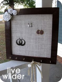 DIY jewelry organizer using one wood picture frame, burlap and a few hooks.