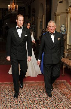 The Prince of Wales walks with The Duke of Cambridge followed by the Duchess of Cambridge and The Duchess of Cornwall, as they leave Clarence House to travel to Buckingham Palace for the evening wedding reception, 29 April 2011.