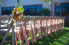 Decorative Touches: fabric hanging from the back row of chairs at an outdoor wedding ceremony