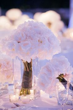 Short clear vases at the bridal party table for the bridesmaids bouquets - have them become a part of the table decor!