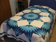 Radiant Star Quilt.  I love this pattern.  The quilter did a great job.  Peace, Robert from nancysfabrics.com