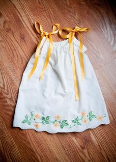 sweet little dresses made from vintage pillowcases.