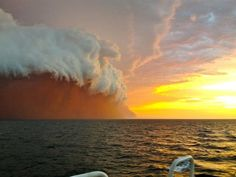 Cloud formation tinged with red dust travels across the Indian Ocean near Onslow, Australia | Jan 9, 2013
