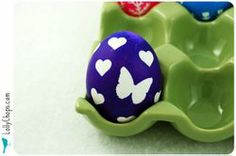 dyed easter eggs idea: punch painter's tape with cool punch, affix to egg dye and remove the tape.