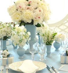 From Carolyne Roehm wedding tables, table settings, white flowers, flower centerpieces, weddings, wedding centerpieces, baby blues, sweet peas, peonies