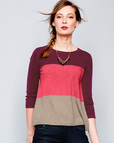 An easy way to modernize classic silhouettes is to pick pieces with color-blocking — swatches of vibrant solid colors. It's a trend you can dress up or down, all year round. Pick a color-block sweater in a flattering trapeze shape — with a flared body but slim-fitting sleeves — along with simple trousers for an elegant but of-the-moment look. - Anne Keane, Lucky Magazine