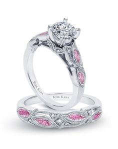 Handcrafted engagement set from the Kirk Kara Dahlia collection. Engagement ring crafted with 0.04 carats of diamonds and 0.43 carats of marquise cut pink sapphires (center stone not included). Shown with matching wedding band crafted with 0.03 carats of diamonds and 0.39 carats of marquise cut pink sapphires.
