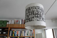studio / lamphade I made out of an encyclopedia -  paperiaarre (Marsha says: make a collage strip of family or vacation pictures, then slide it over the existing lamp shade...)