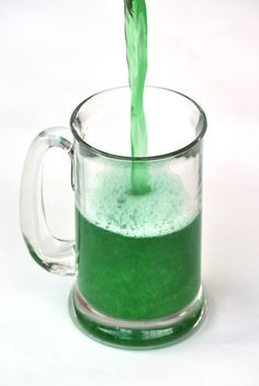 The trick to Green Beer? To avoid flat beer, grab a large frosty beer mug, and squeeze in 3- 5 drops of green food coloring. THEN slowly pour beer from a 12-ounce can or a 16-ounce bottle into the glass. Food coloring first, Beer second.