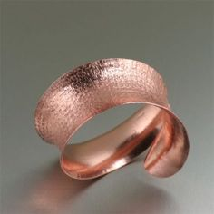 Texturized Anticlastic Copper Bangle Bracelet - This anticlastically raised handcrafted copper cuff bracelet is sure to make a statement.  Simply stunning, this bracelet features a deep textured pattern on the outside, complemented by a highly polished finished on the interior.