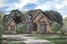 A brick exterior and arched entryway add elements of character and elegance to this Colonial home, which includes 5 bedrooms and 4 ½ baths over its 4231 square feet. House Plan # 151319