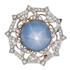 J.E.CALDWELL Star Sapphire Diamond Pin-Pendant  USA  1920  Superb, Edwardian Pendant Brooch by J.E. Caldwell. Platinum top, Gold back, Diamonds and a Star sapphire of approximate 20 Carats. Signed and Numbered.