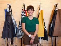Ellen Bennett in front of her Hedley & Bennett aprons at a launch event at the Los Angeles store Poketo.