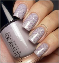 Two coats of Catrice - Sing: Hey, Dirty Lilah! Paisley-like pattern from Konad plate M64. Konad's Princess Special Polish in Light Gray as the stamping polish.  Dots - Millennium from China Glaze.