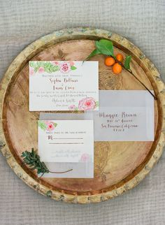 floral wedding invitations with vellum envelopes // photo by Taylor Lord // invites and calligraphy by Rachel Carl Co