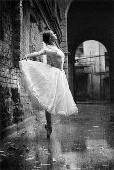Dancer in the rain. Gorgeous but my main thought is about how those pointe shoes are now ruined...