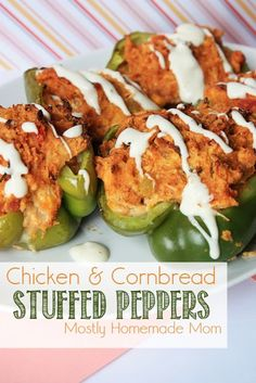 Chicken & Cornbread Stuffed Peppers - Green bell peppers stuffed with cheesy chicken & cornbread, drizzled with a spicy ranch sauce!