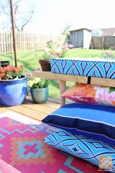 Look at all the delicious color on this beautiful backyard deck! We love that DIY outdoor bench, too. Click through for the full description on The Home Depot Blog.