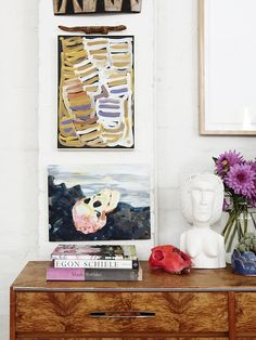 Minnie Pwerle's 'Women Dreamings' painting sits above Carla's skull painting, titled after an Oscar Wilde quote'If you are not too long, I w...