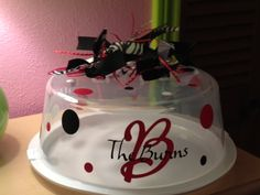 tie ribbon, person vinyl, cake carrier, person cake