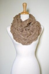 Sparkle in style and warmth with this knitted infinity loop scarf.  Adorned with a silver thread, perfect for adding the right amount of glam to your outfits. $29.99 Use code PINIT at checkout for 10% off your entire order.
