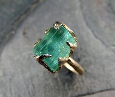 A gorgeous sea-green tourmaline is the centerpiece of this ring.