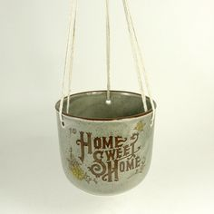 Shipping is $22.00! that's crazy. Vintage 70s Boho Shabby Chic 'Home Sweet Home' Ceramic Hanging Plant Pot Planter. $19.99, via Etsy.