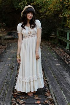 """Vintage 70's Hippie Boho Crochet Lace Wedding Maxi Dress"" from Savannah Marie of Everybody's Buying Vintage (shopEBV on Etsy). WHIMSICAL vintage seventies CROCHET BOHO MAXI. The color is a pretty ""natural white"", almost like an ecru. BEAUTIFUL LACE DETAILS. Puff sleeves. Zip up back. Price: $165.00 (Sold)."