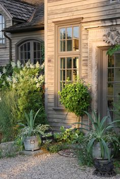love the siding, the pea gravel, and the garden tremendously