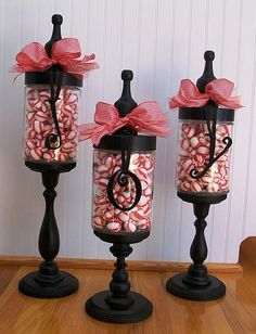 Apothecary Jars for Christmas, but use mason jars, and wooden finials from hardware store.  Candy corn and Boo for Halloween, And then reuse for Christmas with peppermint and joy.
