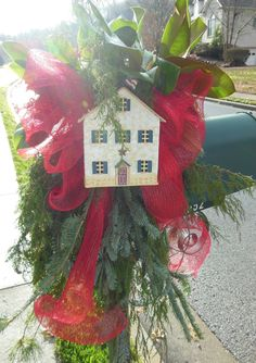 Christmas Mailbox Decoration - specially created for a military family, hosts Evergreens, large Bright Red Deco Mesh Bow and a Tin Home in Red, White and Blue complete with American Flag on top.