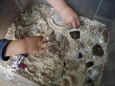 Moon sensory tub, using flour and sand