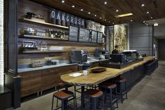 At Oak & Rush in Chicago, casual seating downstairs caters to to-go customers, where planks salvaged from boxcars clad walls, ceilings, and fixtures. idea, coffe shop, coffe bar, coffee shop design, cafe, store design, chicago flagship, retail, starbucks