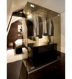 When it comes to closet cool, I don't think it gets much better than this. Designed by the Amsterdam based interior design duo Jeroom Jansen and Bertel Grote of Grand & Johnson, there is just something, oh so James Bond, about this smokey glass closest.