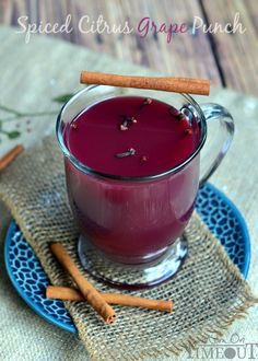 This Hot Spiced Citrus Grape Punch is the perfect beverage to serve up at your holiday celebrations! | MomOnTimeout.com #beverage #punch #re...
