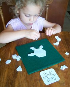 Felt snowflake puzzle - printable little pictures of snowflakes for older kids to try to copy.  (Busy bag idea)