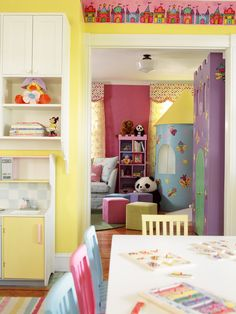 This fantasy playroom for two little girls includes a large castle playhouse containing a stage, dress up closet, puppet theater and tower sleeping loft. Adjoining area houses a craft table, painting area, chalk board and miniature kitchen