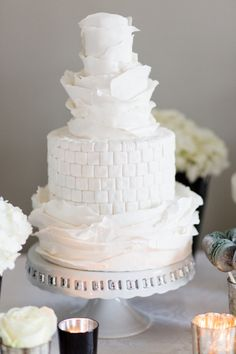 White detailed cake: http://www.stylemepretty.com/little-black-book-blog/2014/04/02/wedding-cake-inspiration-from-cakes-by-krishanthi/ | Photography: Eddie Judd - http://eddiejuddphotography.com/