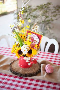 Cute Table Centerpiece from this Cowboy + Cowgirl Joint Birthday Party via Kara's Party Ideas KarasPartyIdeas.com #westernparty #barnyardparty #cowgirlcupcakes