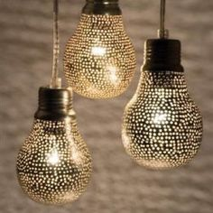 love this lighting. at first i thought they were altered lightbulbs, but they're actually made of plated copper sheets.
