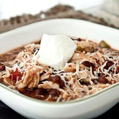Slow Cooker Chipotle Chicken & Black Bean Chili 3 Chopped chicken breasts 2 can black beans 2 cans diced tomatoes with chiles chopped green pepper chipotle adobo sauce garlic cumin salt and pepper Throw it all in the crock pot until chicken is tender, garnish with mozzarella, sour cream, etc.