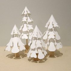 These Snowy Paper Trees look like they're straight out of a magazine. You'd never guess that you could make these in under and hour. Or that it'll cost you less than $10 to make.