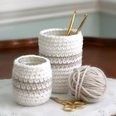 Re-purpose jars and cans into cute organizational containers with crochet cozies. Photo tutorial.