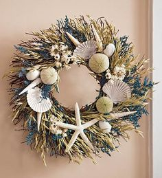 "Plow & Hearth Exclusive    If you love the beach, you'll love this wreath. Starfish, fan shells, sea urchins and more are intertwined with ammobium, blue caspia, natural avena and beach grass on a natural twig base into this cache of seashore treasures.     Size  Approx. 16"" dia."