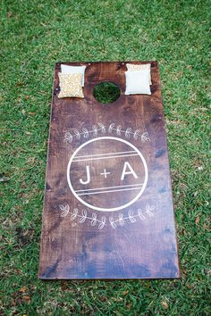 Wood stained and monogrammed corn hole boards. | Southern Weddings