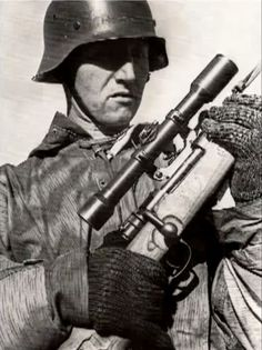 German sniper on the Eastern front. Note the woodland camouflage smock. The pattern is still used by the German army with little change.